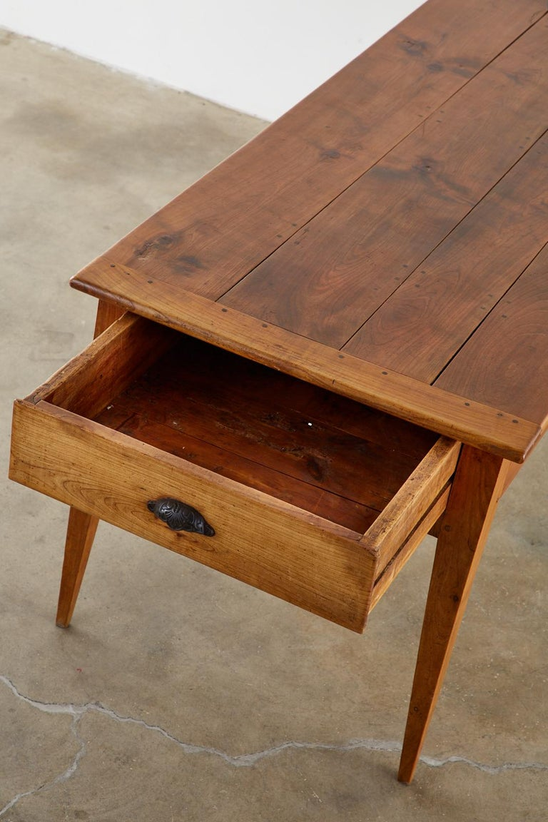19th Century French Provincial Farmhouse Fruitwood Dining Table For Sale 13