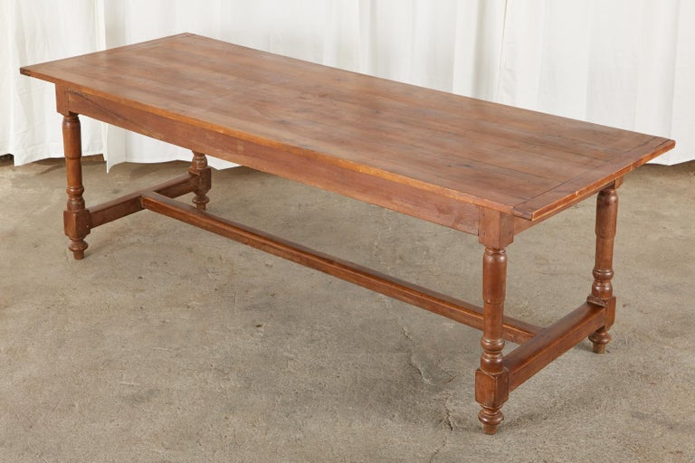 Hand-Crafted 19th Century French Provincial Farmhouse Fruitwood Trestle Table For Sale