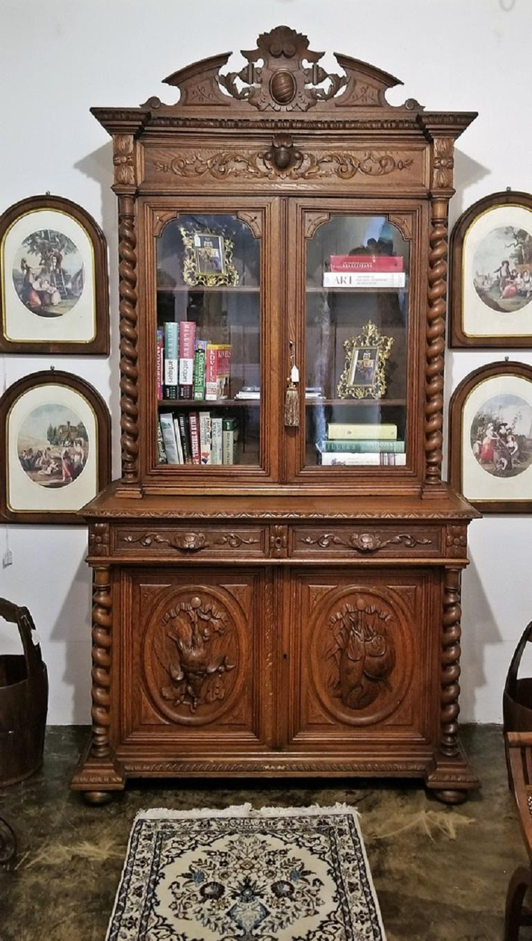Hand-Carved 19th Century French Provincial Highly Carved Oak Hunt Bookcase For Sale