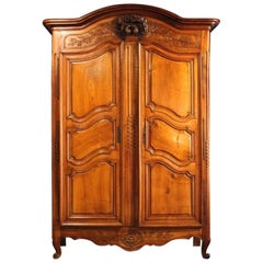 19th Century French Provincial Walnut and Cherryood Armoire with Carved Doves