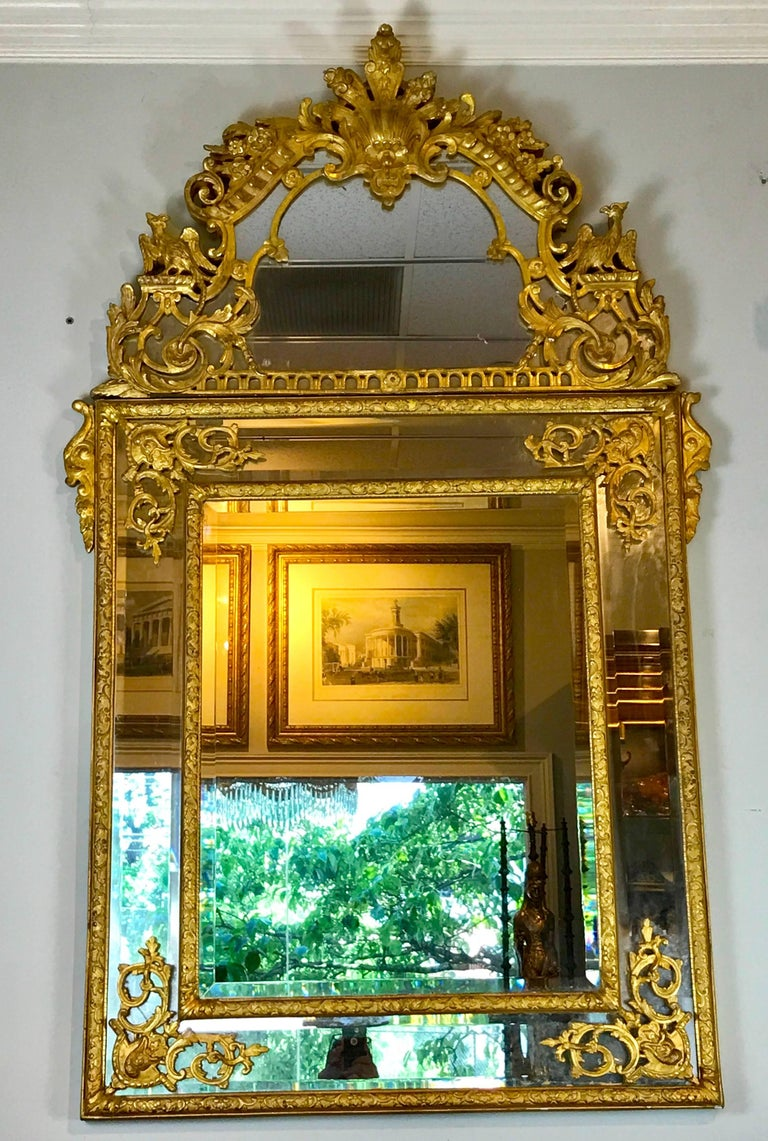 19th century French Regence style giltwood mirror, a substantial finely carved, gesso and water gilt mirror with original or antique mirror. 42