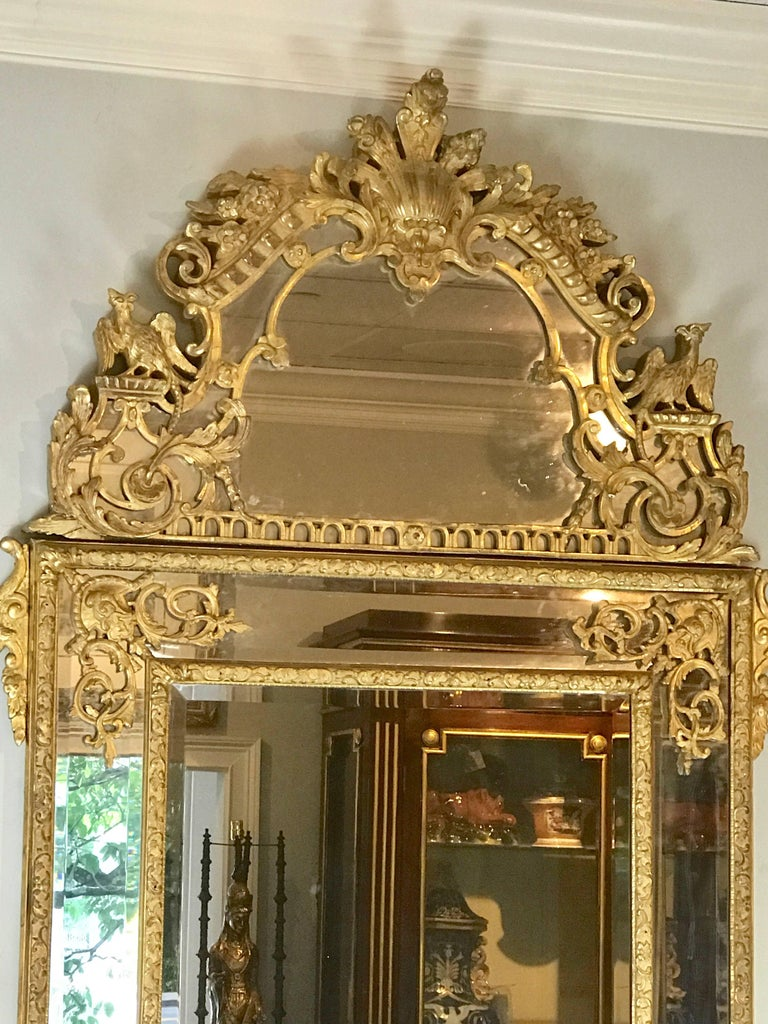 Carved 19th Century French Regence Style Giltwood Mirror