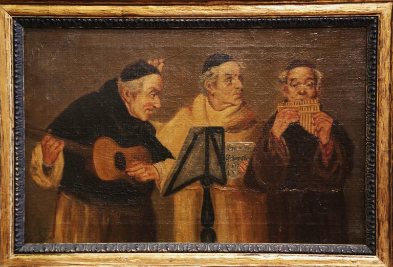 Created in France, circa 1880 and set in a carved gilt frame, the antique painting depicts three jovial monks playing music instruments in the style of Eduard Von Grutzner. The art work is signed in the lower left corner by the artist, but