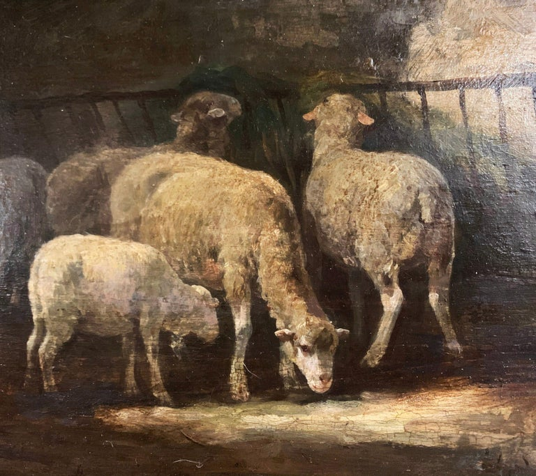 Set in the original carved giltwood frame, this charming, antique oil on board painting was created in France, circa 1890. The rectangular composition depicts a group of sheep grazing in a barn. The painting shows the artist's masterful use of