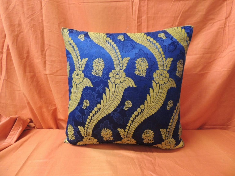 19th century French silk brocade Royal blue square decorative pillow. Gold scrolling vines and flowers are embroidered with gold metallic threads onto silk royal blue damask textile. Accent pillow framed with golden silk, same as backing and