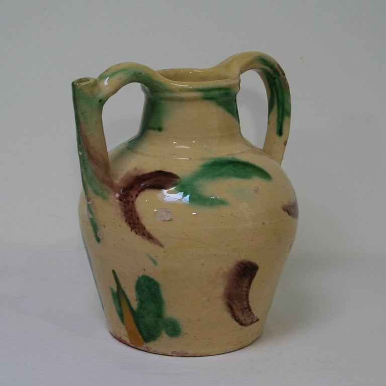 Great authentic and rare piece of pottery with a spout in handle from the Provence. Wonderful colours Very good condition, France, circa 1850-1900.