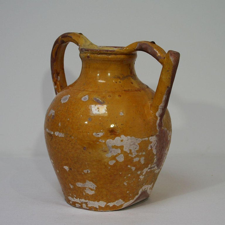 Great authentic and rare piece of pottery with a spout in handle from the Provence. Beautiful weathered and an amazing color. Imperfections help authenticate this water cruche as it was a utilitarian type piece, France, circa 1850.