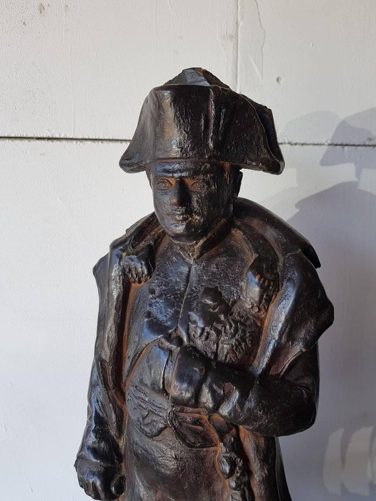 19th century large size terracotta statue depicting Napoleon Bonaparte made by a unknown artist and has some old damage to the hat which is restored only by color.  The measurements are, Depth 20.5 cm/ 8 inch. Width 22 cm/ 8.6 inch. Height 55