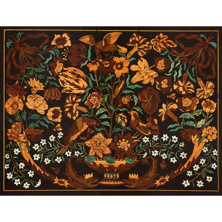 This exceptionally detailed wooden marquetry panel exhibits some of the highest quality of French craftsmanship and design. The panel is of rectangular form, and features a strikingly detailed and intricate composition of a huge bouquet of flowers