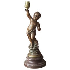 19th Century French Wooden Table Lamp with Raised Cherub