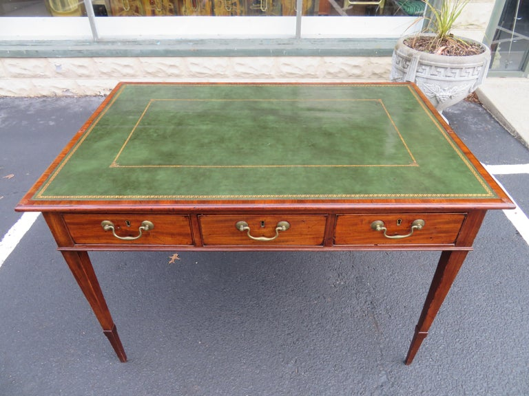 Antique George III leather and mahogany double sided partner writing table desk. We love the original tooled green and gold inlayed leather top against the nicely aged patina of the mahogany wood-very charming in-deed! A very attractive writing desk