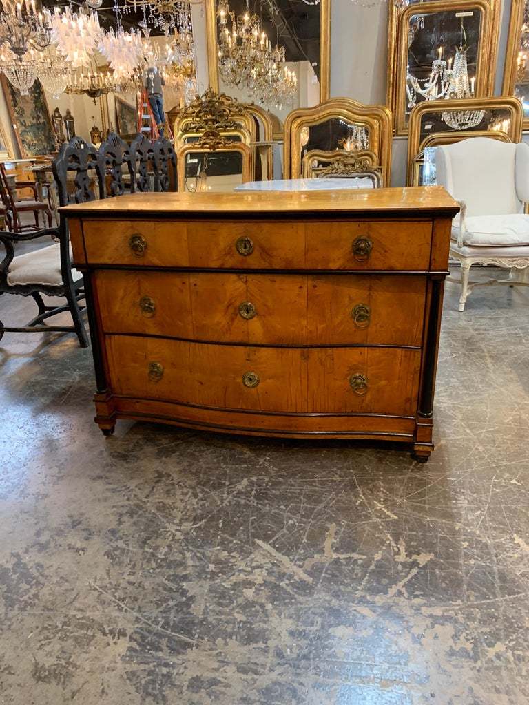 Very handsome German 19th century Biedermeier walnut commode. The piece has nice ebonized details and a beautiful finish. Ample storage as well!