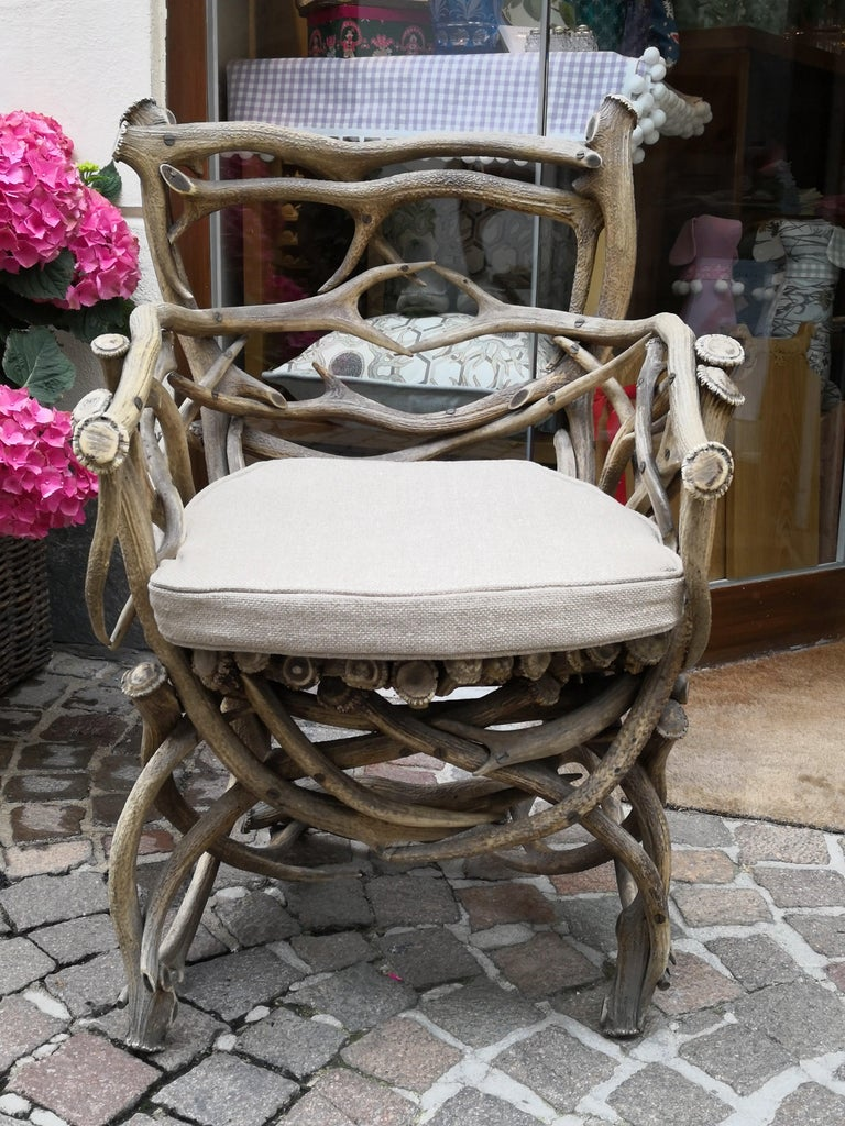 19th century German antler trophy armchair completely handcrafted from a large range of antler trophies with armrests in the style of Black Forest. This armchair is part from a German hunting salon interieur. Dated 1892 in the Horn. A made by