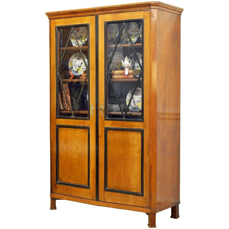 19th Century German Fruitwood and Ebonized Biedermeier Two-Door Book Case For Sale