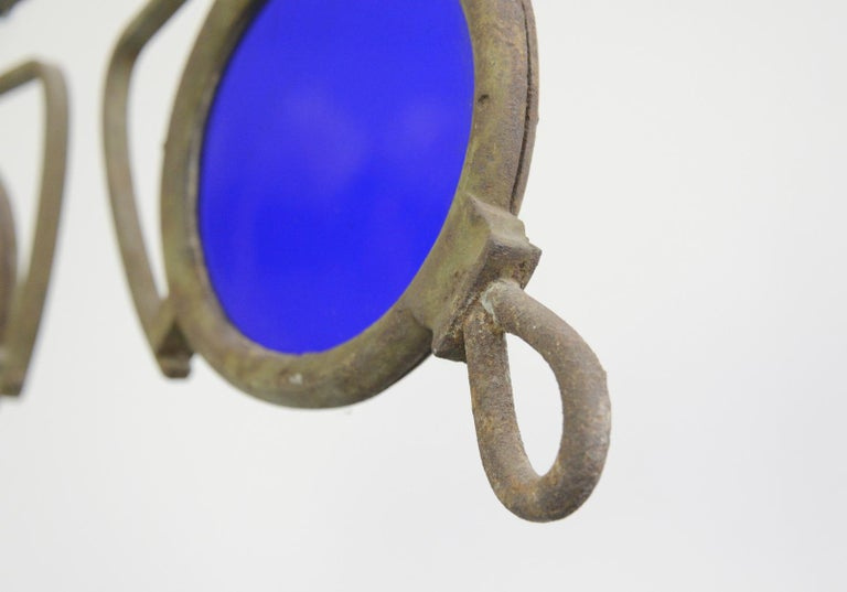 19th century German opticians trade sign  - Wrought iron frame - Original hand blown cobalt blue glass - German, 1890 - 78cm long x 3cm deep x 32cm tall  Condition report  Some patina to the iron surface and some bubbles in the glass, no