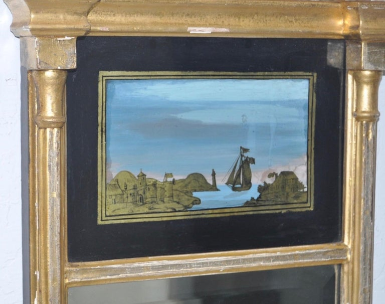 19th century gilded and painted Trumeau mirror  This is a beautiful antique mirror. There is ample amount of loss to the gilding, but this is easily restored, or displayed as is. Please see all images.  Elegant Doric columns on each side with a