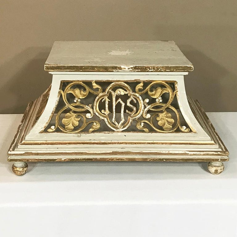 19th century gilded and painted wood pedestal features pierce-carved, curved sides with a base larger than the display surface which creates extra stability in style! Ivory painted finish has achieved a lovely patina over the decades, and is