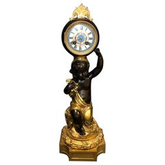 19th Century Gilt and Patinated Figural Clock