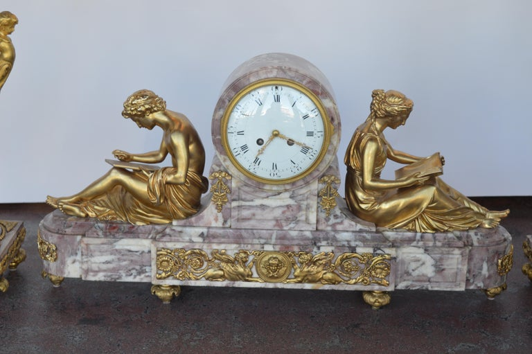 19th century gilt bronze ormolu and marble clock set.