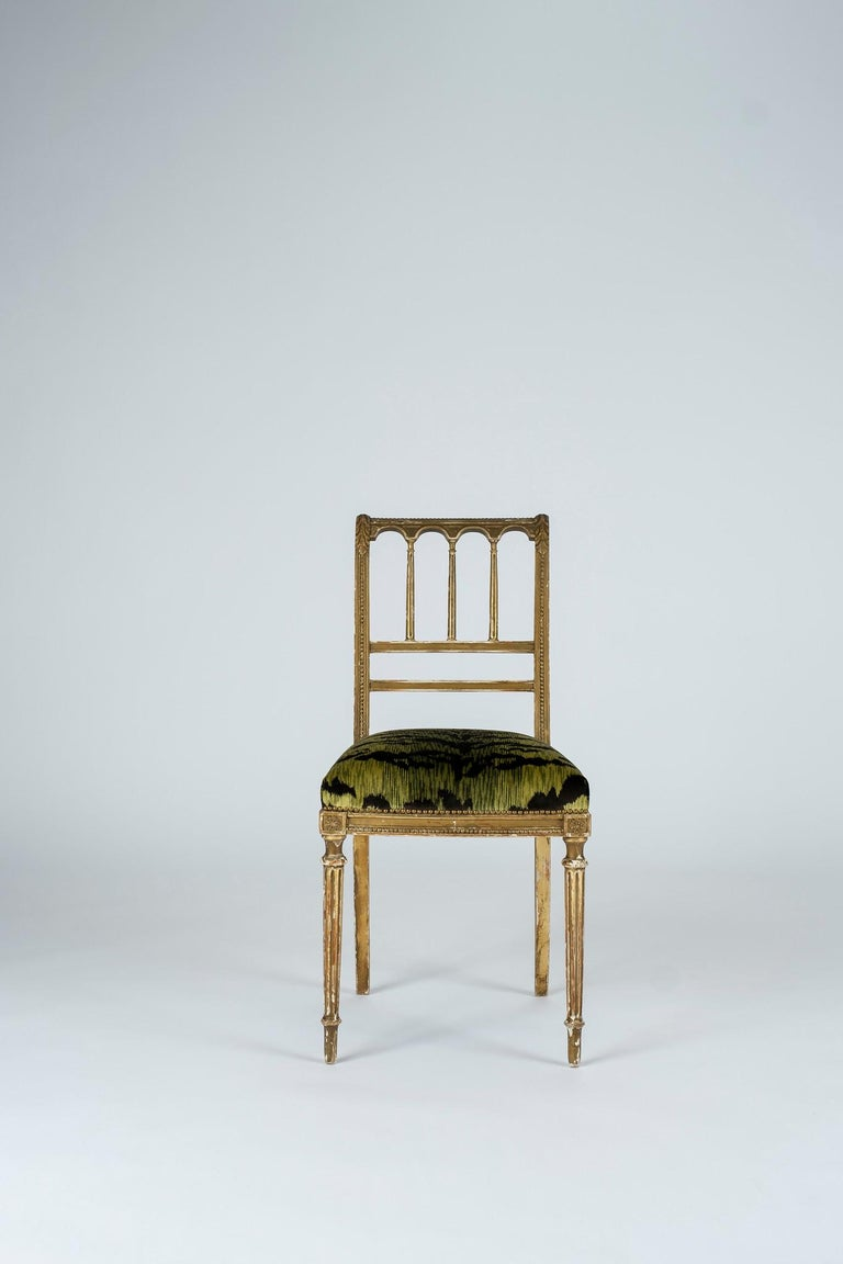 Green with envy are these delightful 19th century Louis XVI style giltwood music chairs. These are newly upholstered in a luxurious Luigi-Bevilacqua green shine Tigre velvet. Sold individually, two available.