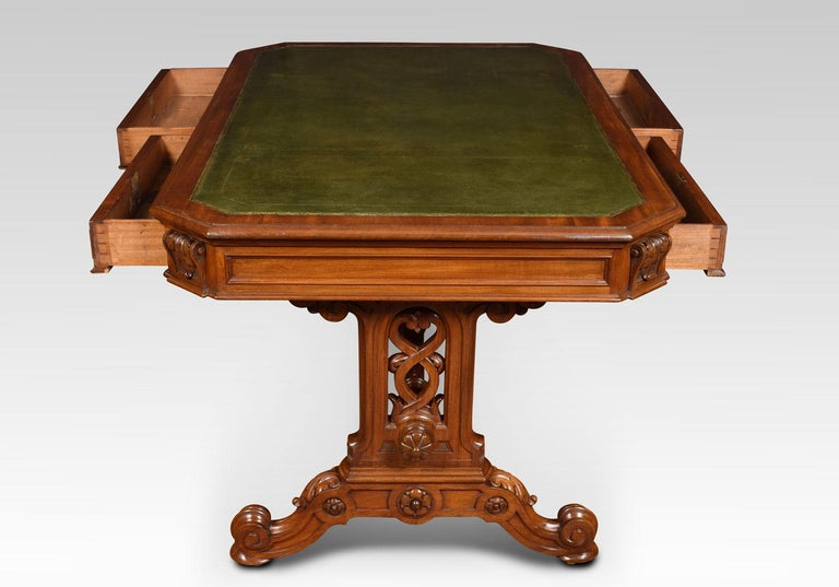 19th century mahogany Gothic style library table, the large rectangular top with canted corners having tooled inset leather writing surface. The freeze fitted with two moulded draws and two opposing draws. One draw stamped Johnstone & Jeanes, 67 New