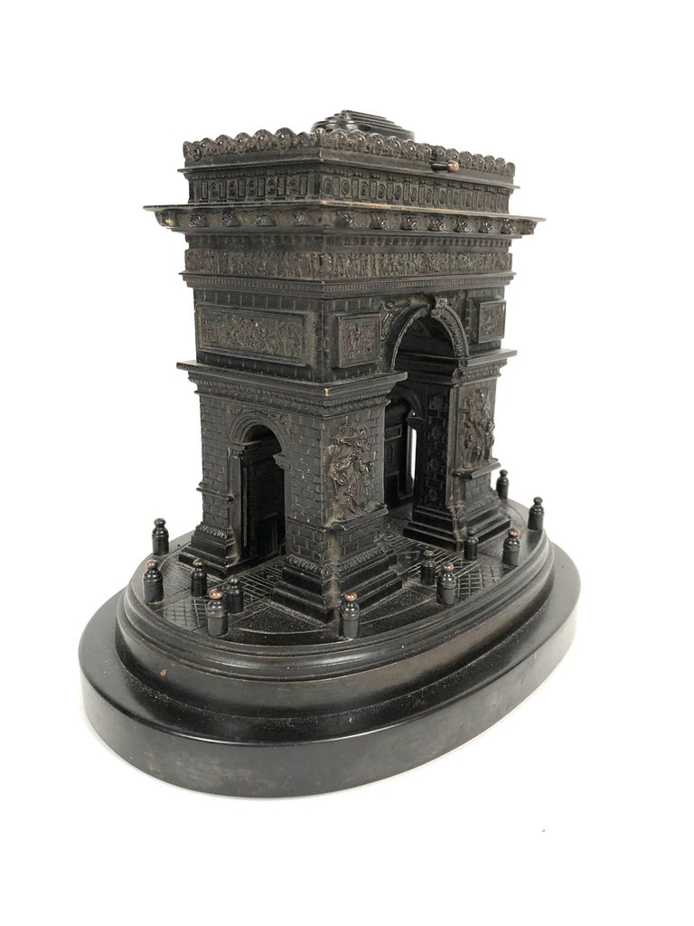 A generously sized and well detailed Grand Tour bronze architectural model of the Arc de Triomphe in Paris, mounted on anvil black marble base. Created as a high end souvenir in the late 19th century for travelers to Paris, this model is very well