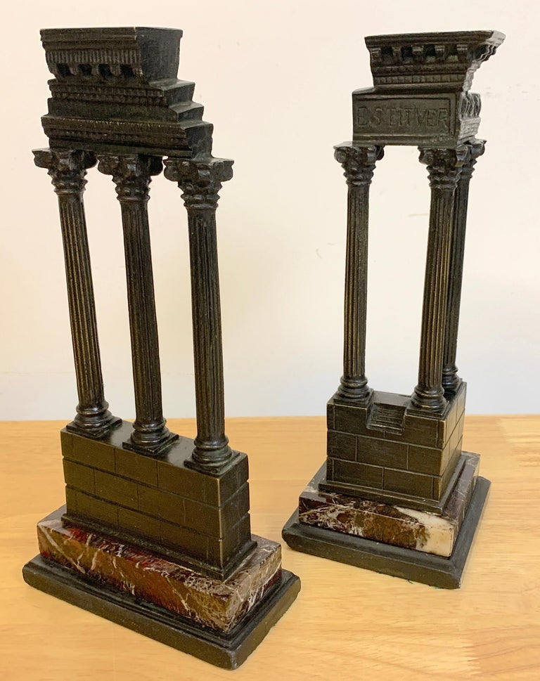 19th century Grand Tour bronze models roman forum columns, depicting the temple of castor and Pollux and the temple of Vespasian from the Roman Forum, raised on rouge marble bases. Measures: Temple of castor and Pollux 5.75