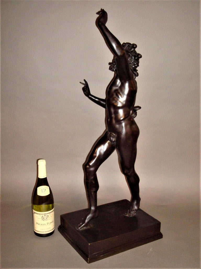 19th century large grand tour bronze sculpture of The Dancing Faun; this classical figure of substantial scale and of good quality with a dark patination standing on a stepped rectangular plinth.  The original excavated in Pompeii in 1830, now on