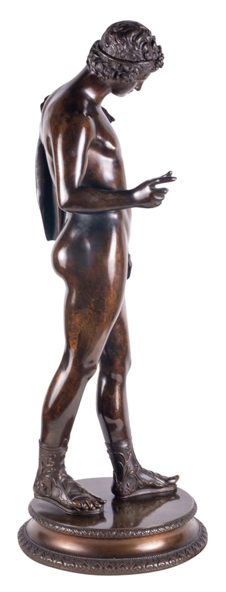 A very good quality Grand Tour patinated bronze figure of Narcissus, dating from the last quarter of the 19th century.  Narcissus was a hunter in Greek mythology and he was distinguished for his beauty.  This well patinated bronze classical