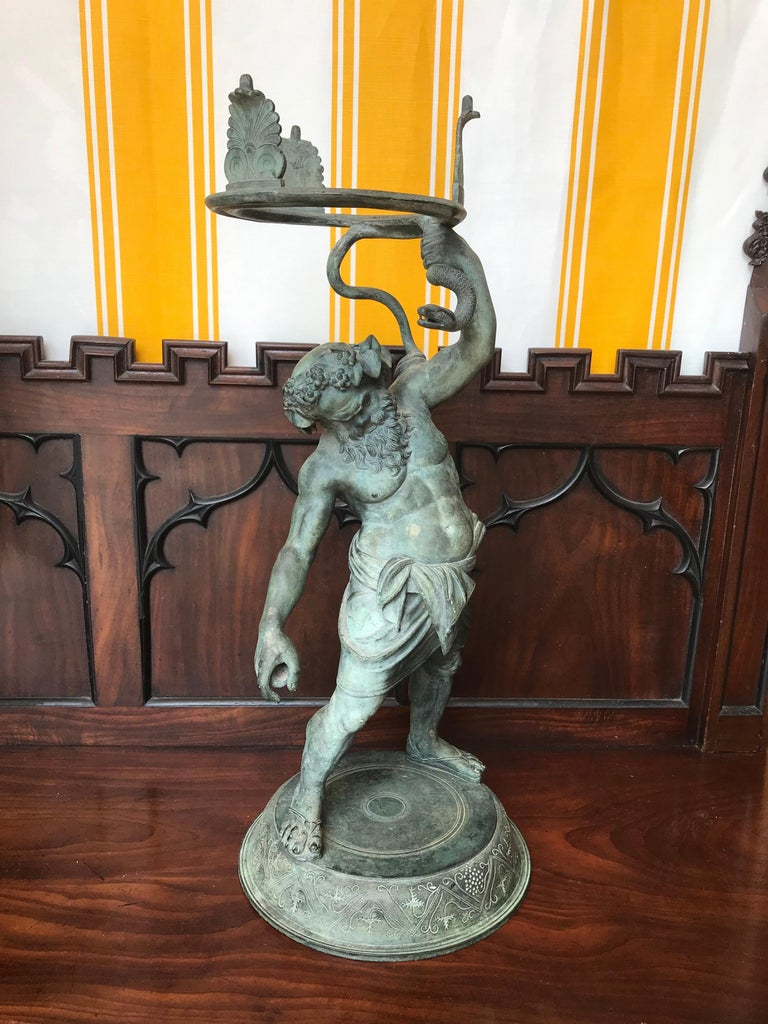 19th century Grand Tour patinated bronze figure statue of Silenus, The God of Wine.  - Identical to that found in Herculaneum.  An Greek mythology, Silenus was the tutor of the god Dionysus. His features are similar to those of a satyr, but he