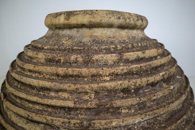 Peloponnesian Koroni jar naturally weathered into a beautiful dark patina with lichen. Typical
