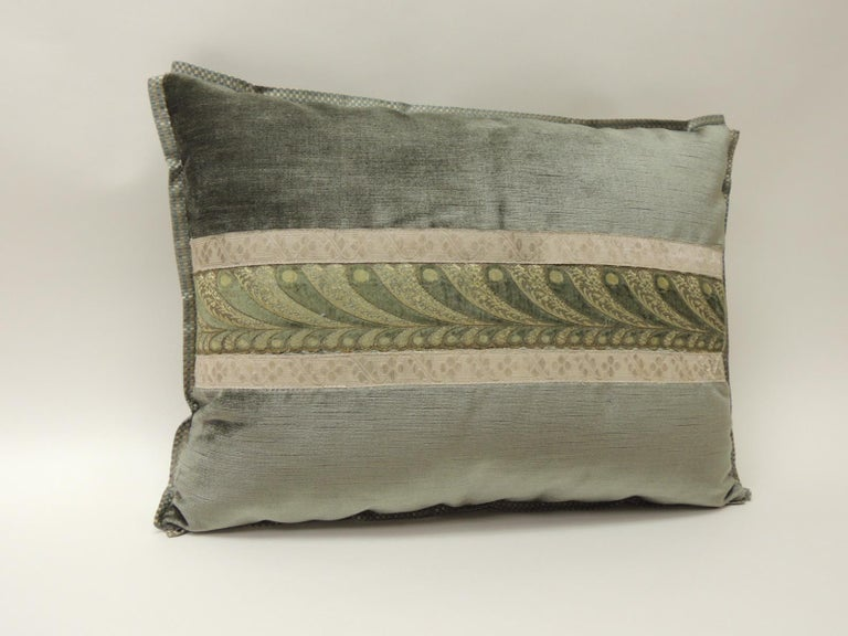 19th century green and silver antique velvet ribbon decorative bolster pillow 19th century green and silver decorative bolster pillow with antique ribbon. Decorative bolster pillow embellished with an antique woven and embroidery velvet French