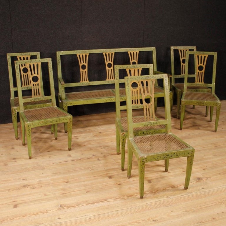 Group of six Italian 19th century chairs. Furniture in carved, gilded, lacquered and hand painted wood with very pleasant floral decorations. Not original gilding, lacquering and painting taken in the first half of the 20th century. Chairs that are