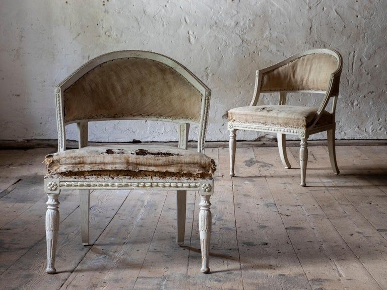 A fine pair of early 19th century Gustavian barrel back armchairs in original color and padding, circa 1800, Stockholm, Sweden.  Signed by Stockholm chair master Ephraim Stahl (1767-1820). Supplier to the Royal Court and one of the most