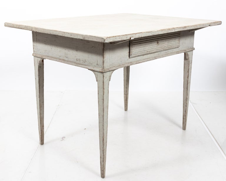19th century Gustavian side table with a single reeded front drawer. Please note of wear consistent with age including paint loss. Made in Sweden.