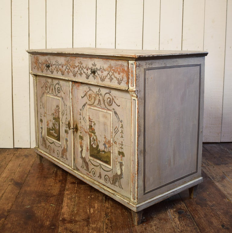 This 19th century pine cupboard is painted with figural and Chinese themes.