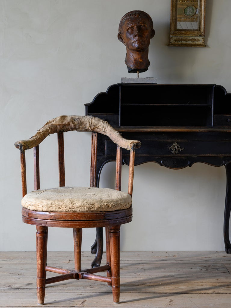 Remarkable 19th-century Gustavian revolving desk chair in its original condition, circa 1810, Sweden.  The condition of the chair is very good containing its original finish and padding to the seat cushion and backrest. There are two historic