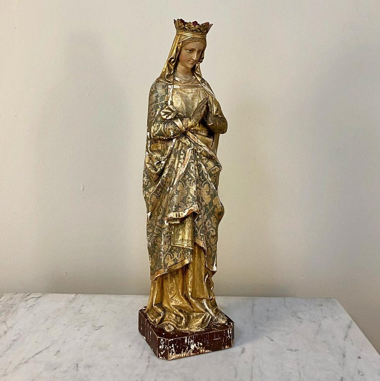 19th century hand carved and painted Madonna is an inspiring and uplifting sculpture that has been artfully carved and meticulously hand painted by a talented sculptor. The look on the Virgin Mary's face is one of serenity as she clasps her hands in