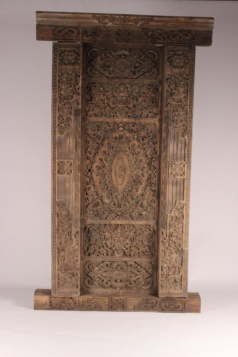 An ornate and highly skilled early example of hand carved Balinese Temple door. Discovered in the interior of the Island near Ubud by our principle Director some 22 years ago. Having travelled extensively with a guide, we uncovered a treasure trove