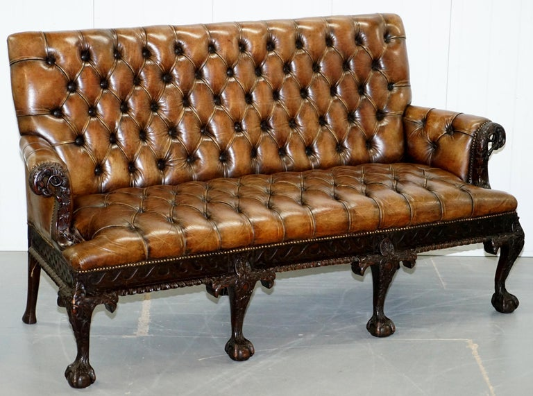 We are delighted to offer for sale this absolutely stunning Georgian Irish style Victorian Chesterfield brown leather sofa with hand carved Lion hairy paw feet and eagle detailing 