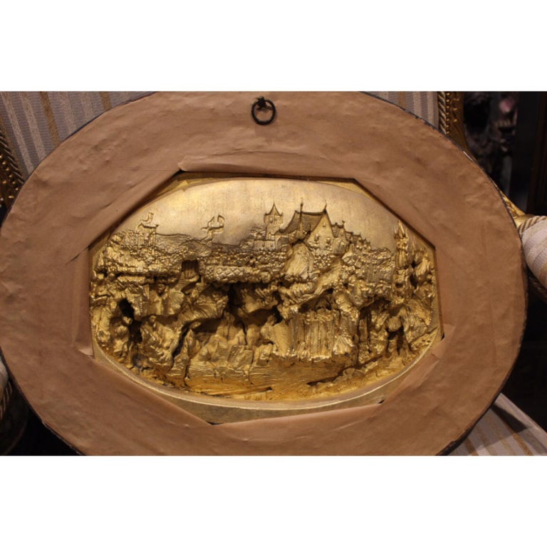 A large hand carved meerschaum bas relief plaque by Justin Mathieu; the scene shows Joan of Arc with her troops. The carving is intricate and very detailed. Meerschaum is a form of mineral known as sepiolite; it is sometimes found floating on the