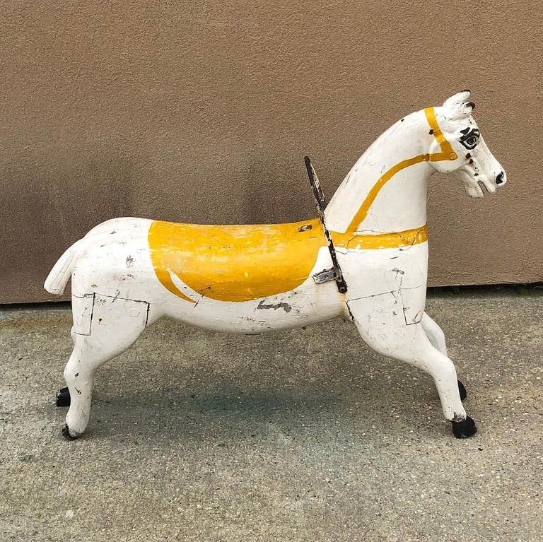 19th century hand painted carved wood Carousel Horse is a splendid artifact of nostalgia, back when huge, brightly lit carousels were the centerpiece of traveling amusement parks, fairs and circuses during their heyday in the 19th century. This