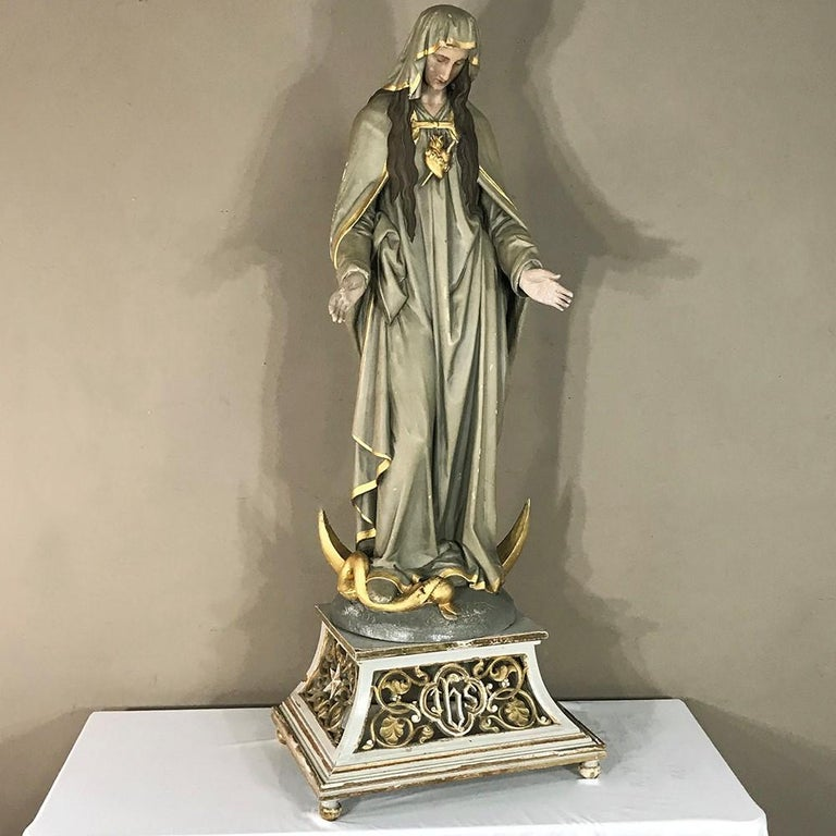 19th century hand-painted polychrome Madonna is a wonderfully sculpted depiction of the Virgin Mary that was artistically hand-painted then given a polychrome finish to last for centuries, a technique first developed in ancient Greece, circa