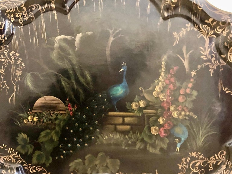19th century hand painted tole serving tray or large platter. Depicting beautiful peacocks amidst a garden of fruit.