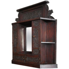 19th Century Handcrafted Oakwood Folk Art Wall Cabinet with Beveled Mirror