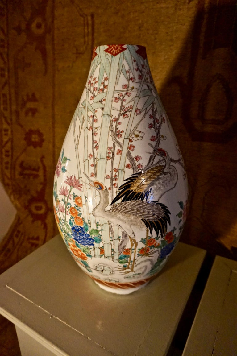 Large Japanese Conical vase in the style of Famille Verte with exquisitely painted cranes and flying song birds amidst spring foliage. Some hairline cracks are visible but these do not detract from the Fine Art work on display in the scenes