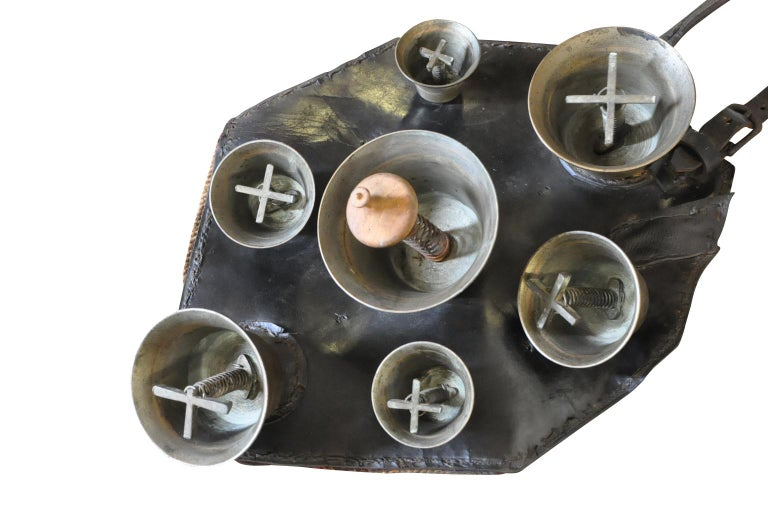A delightful mid-19th century Herder's Cowbells. A fabulous collection of bronze bells attached to padded leather. The herder would wear this piece on his backs. Walking, the bells make the most beautiful tones. The cows would follow the herder from