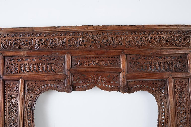 Hand-Crafted 19th Century Indian Carved Wood Panel Window Surround For Sale