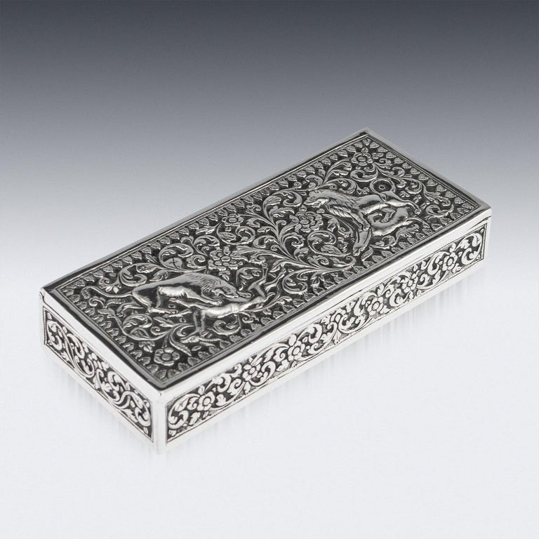 Antique late 19th century Indian Kutch (Cutch) solid silver stamp box, of octagonal form, impressively heavy gauge and exceptionally fine workmanship, the lid depicting a lion and a lioness killing an antelope, surrounded by foliate and floral