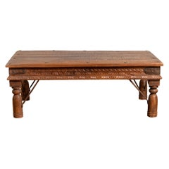19th Century Indian Rustic Low Coffee Table with Carved Apron and Iron Accents